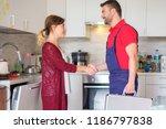 satisfied housewife handshaking ... | Shutterstock . vector #1186797838