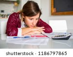 sad woman with many debts... | Shutterstock . vector #1186797865