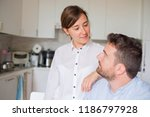 happy couple forecasting home... | Shutterstock . vector #1186797928