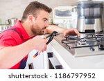 installing a new hob in modern... | Shutterstock . vector #1186797952