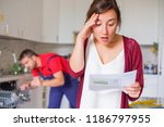 housewife shocked after reading ... | Shutterstock . vector #1186797955