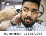 unshaven young black man being... | Shutterstock . vector #1186871038