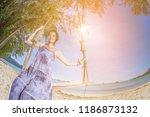 woman enjoying nature | Shutterstock . vector #1186873132