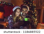 couple in love sitting next to... | Shutterstock . vector #1186885522