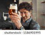 mature man examining the... | Shutterstock . vector #1186901995