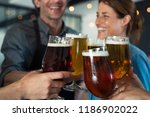 happy friends clinking glasses...   Shutterstock . vector #1186902022