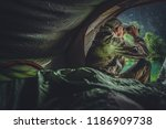 Game Spotting From a Tent. Caucasian Hunter and the Hunting Season. - stock photo