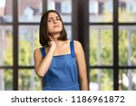 young woman having neck pain.... | Shutterstock . vector #1186961872