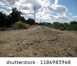 stony dirt road and sky with... | Shutterstock . vector #1186985968