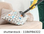 janitor removing dirt from sofa ... | Shutterstock . vector #1186986322