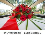 a coffin with a flower... | Shutterstock . vector #1186988812