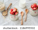 overnight oats with... | Shutterstock . vector #1186995532
