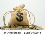 money bags put on the pile of...   Shutterstock . vector #1186996045