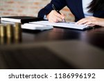 businessmen calculate... | Shutterstock . vector #1186996192