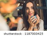 selective focus of pretty woman ... | Shutterstock . vector #1187003425