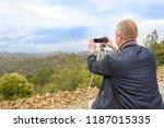 travel photographer man taking... | Shutterstock . vector #1187015335
