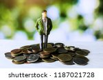 businessman standing on money... | Shutterstock . vector #1187021728