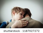 father comforting stressed sad... | Shutterstock . vector #1187027272
