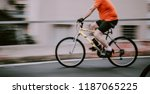 cyclist ridind bike fast... | Shutterstock . vector #1187065225