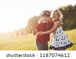 brother and sister are playing... | Shutterstock . vector #1187074612