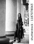 beautiful girl in a coat in... | Shutterstock . vector #1187078065