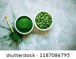 scattered spirulina powder in... | Shutterstock . vector #1187086795