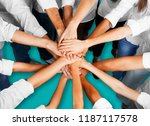 handshake of many young... | Shutterstock . vector #1187117578
