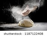 Chef Scattering Flour While...