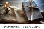 religious old book on a wooden... | Shutterstock . vector #1187126848