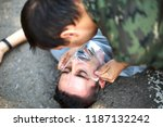 man giving first aid to a... | Shutterstock . vector #1187132242