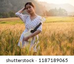 asian woman with ukulele in... | Shutterstock . vector #1187189065