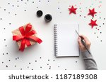 woman writing good wishes or...   Shutterstock . vector #1187189308