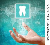 Tooth Symbol on hand,medical icon - stock photo