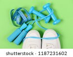 sneakers with skipping rope and ... | Shutterstock . vector #1187231602
