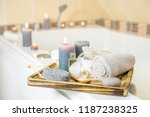 candles burning and spa... | Shutterstock . vector #1187238325