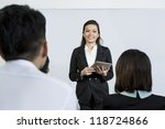 Chinese Business woman giving presentation with a Digital Tablet - stock photo