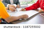 three hands of men and woman... | Shutterstock . vector #1187255032