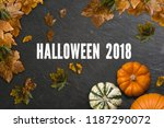 frame of leaves and pumpkins on ... | Shutterstock . vector #1187290072