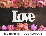 frame of flowers on wooden... | Shutterstock . vector #1187290075