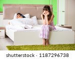 woman and man in the bedroom... | Shutterstock . vector #1187296738