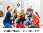 a group of friends with  guitar ...   Shutterstock . vector #1187310145
