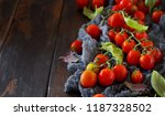 cherry tomatoes and basil  on a ... | Shutterstock . vector #1187328502