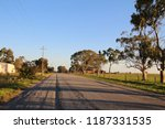 a rural dirt or gravel road... | Shutterstock . vector #1187331535