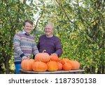 elderly men with orange... | Shutterstock . vector #1187350138