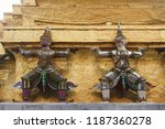 close up of two demon statues ... | Shutterstock . vector #1187360278