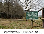 a sign on a rural farm road... | Shutterstock . vector #1187362558
