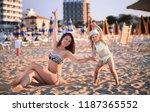 beach scene. happy woman and... | Shutterstock . vector #1187365552