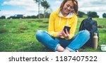 smile women holding in female... | Shutterstock . vector #1187407522