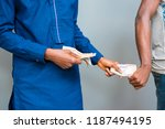 Small photo of a man giving bribe. a man collecting a bribe