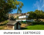 a historic ranch house on a... | Shutterstock . vector #1187504122